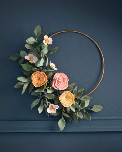 felt flowers set on one side of a hoop