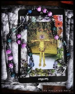 Sacrifice card, Reversed from The Sacred Circle Tarot
