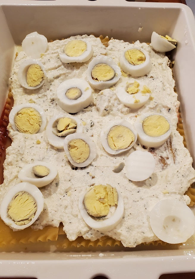 this is a layer of boiled egg in baked lasagna