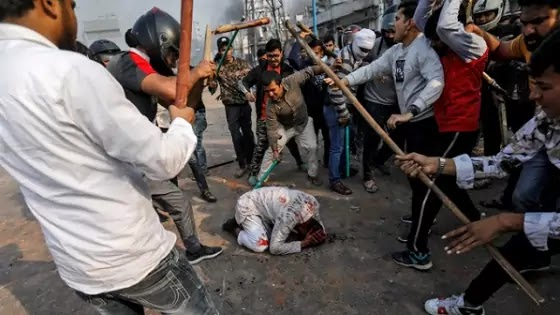 Hindutva beating a Muslim man, Who is behind the Delhi violence? India