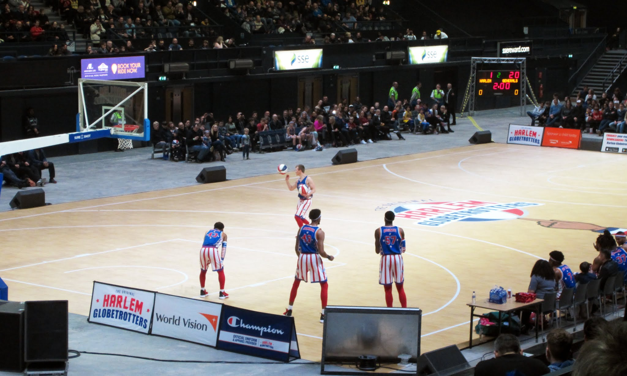 """Paweł """"Dazzle"""" Kidoń of the Harlem Globetrotters spins a ball"""