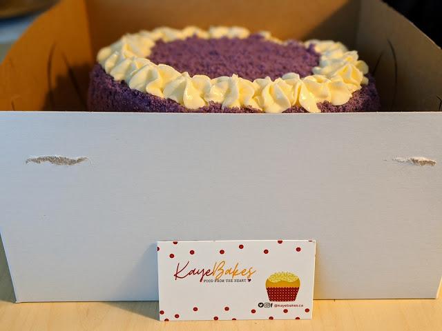 Box of ube cake and calling card of Kaye Bakes