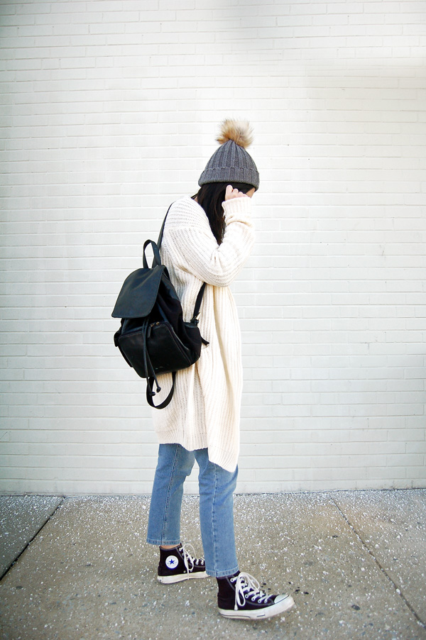 White Cardigan, Blue Jeans, Black Sneakers, Backpack