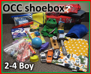 Operation Christmas Child shoebox for 2 to 4 year old boy with clothing.