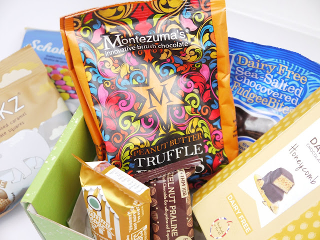 an assortment of bags, boxes, and bars of vegan chocolate