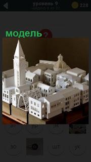 сделана модель небольшого города со стенами и башней