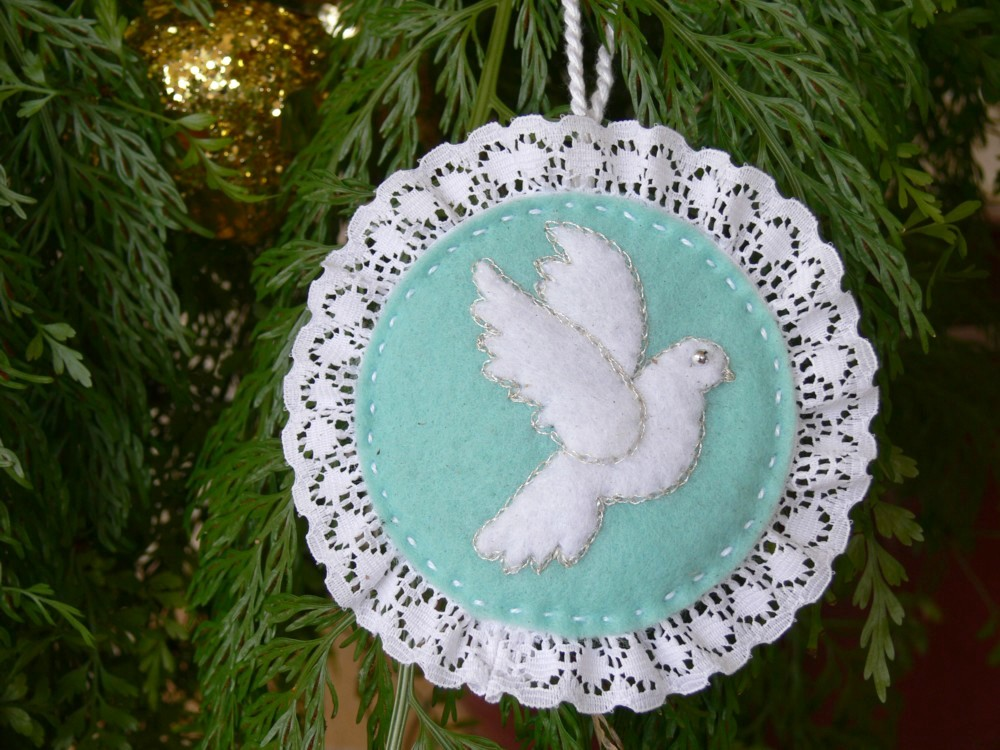 the dove is outlined with silver metallic thread but it would look just as lovely if you used gold then ive used some lace around the edge which was very