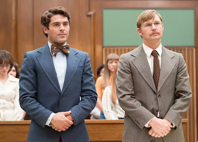 Netflix's film Extremely Wicked, Shockingly Evil and Vile 2019 movie still where Zac Efron, playing Ted Bundy, stands up in court to face his sentence
