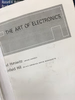 The Art of Electronics, by Horowitz and Hill, superimposed on Intermediate Physics for Medicine and Biology.