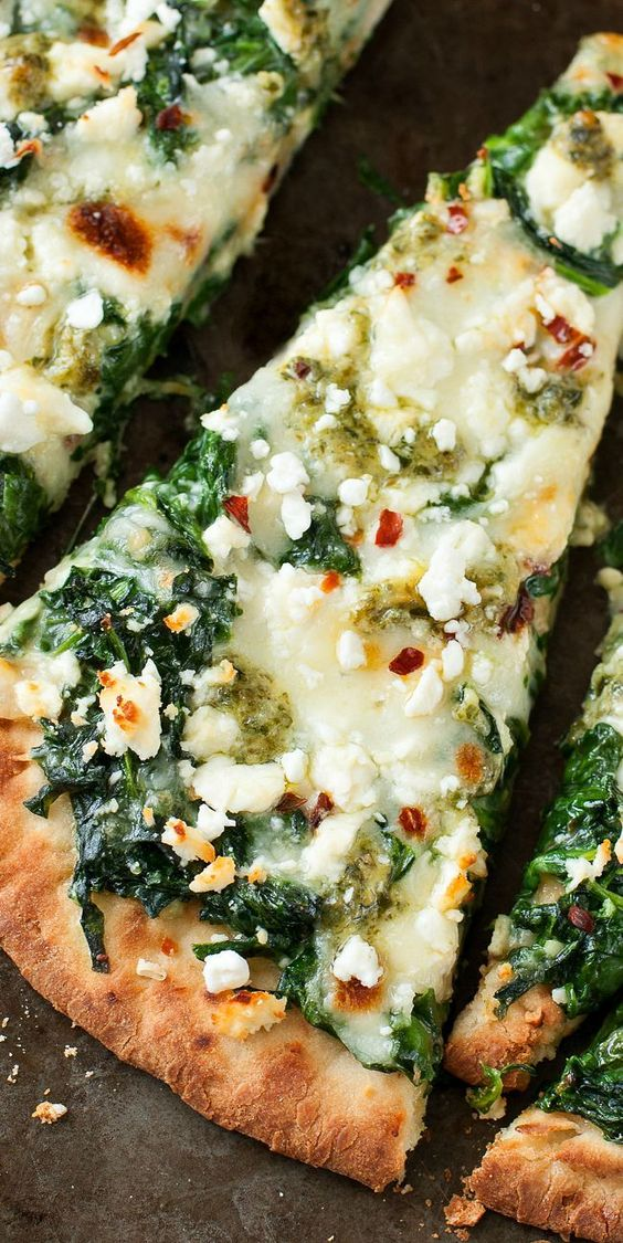 Aiming to eat more veggies? This Three Cheese Pesto Spinach Flatbread Pizza packs an entire box of spinach into one glorious single-serving pizza!