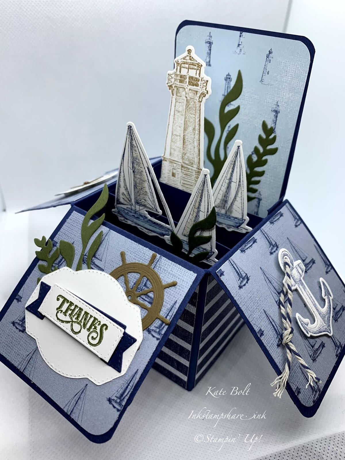 This is a card in a box with boats, light house, anchor, compass and seaweed, using the Lets Sail Away stamps, dies and paper from Stampin Up