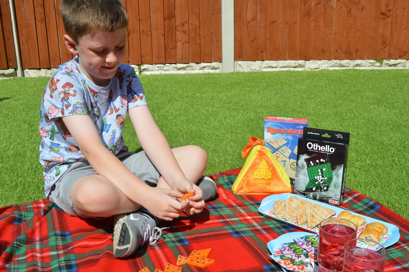 Boy playing games while having a picnic