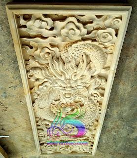 Relief batu alam motif naga meninggi