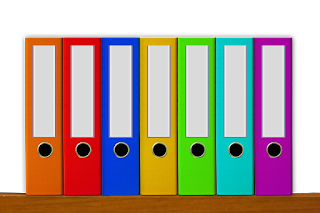 files of various colors on shelf