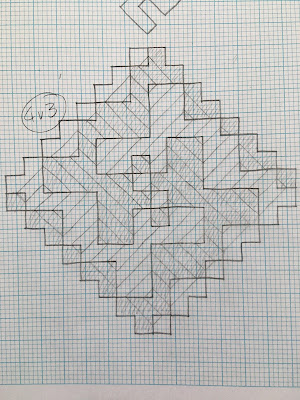 A spiral motif formed from intersecting diagonal lines, drawn in pencil on graph paper, with the areas containing left slanting lines shaded in