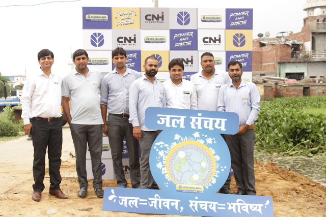 Representatives from CNH Industrial and its New Holland Agriculture brand proudly display the CSR project logo: Water Conservation, Water= Life, Conservation = Future
