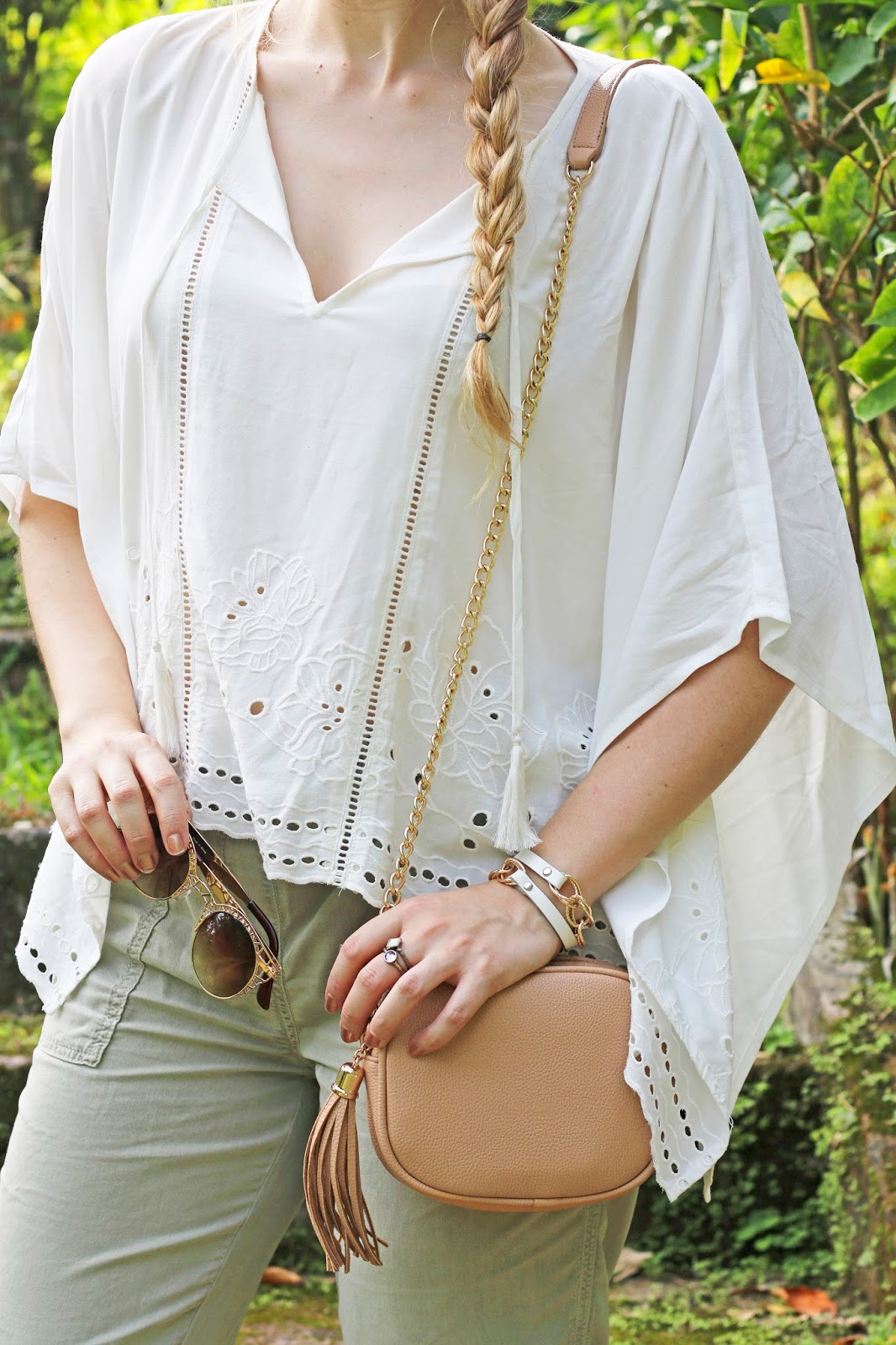 A flowy white poncho top is essential for Summer!