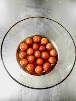 Gulab jamun dipped in sugar syrup for gulab jamun recipe