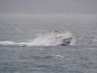Jugo, kiša trajekti Supetar - Split slike otok Brač Online