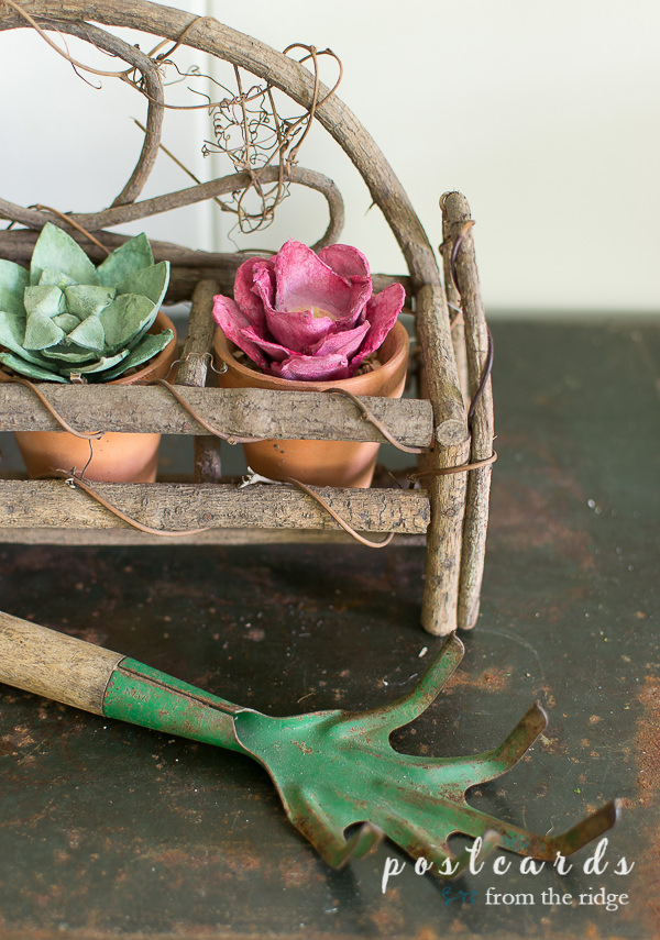 vintage garden hand rake and flowers made from paper egg cartons