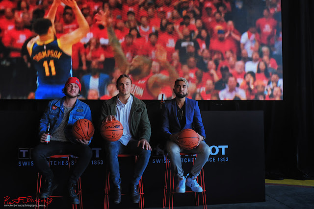 Portrait of three young men trying out the hosts chairs at the end of the event - TISSOT NBA Finals Party Sydney - Photography by Kent Johnson.