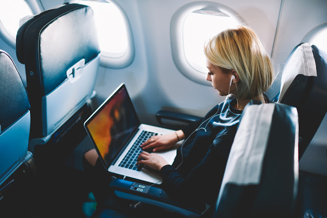 Woman working on transatlantic flight from Iceland to North America