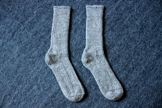 2 grey alpaca and nylon yarn socks next to each other
