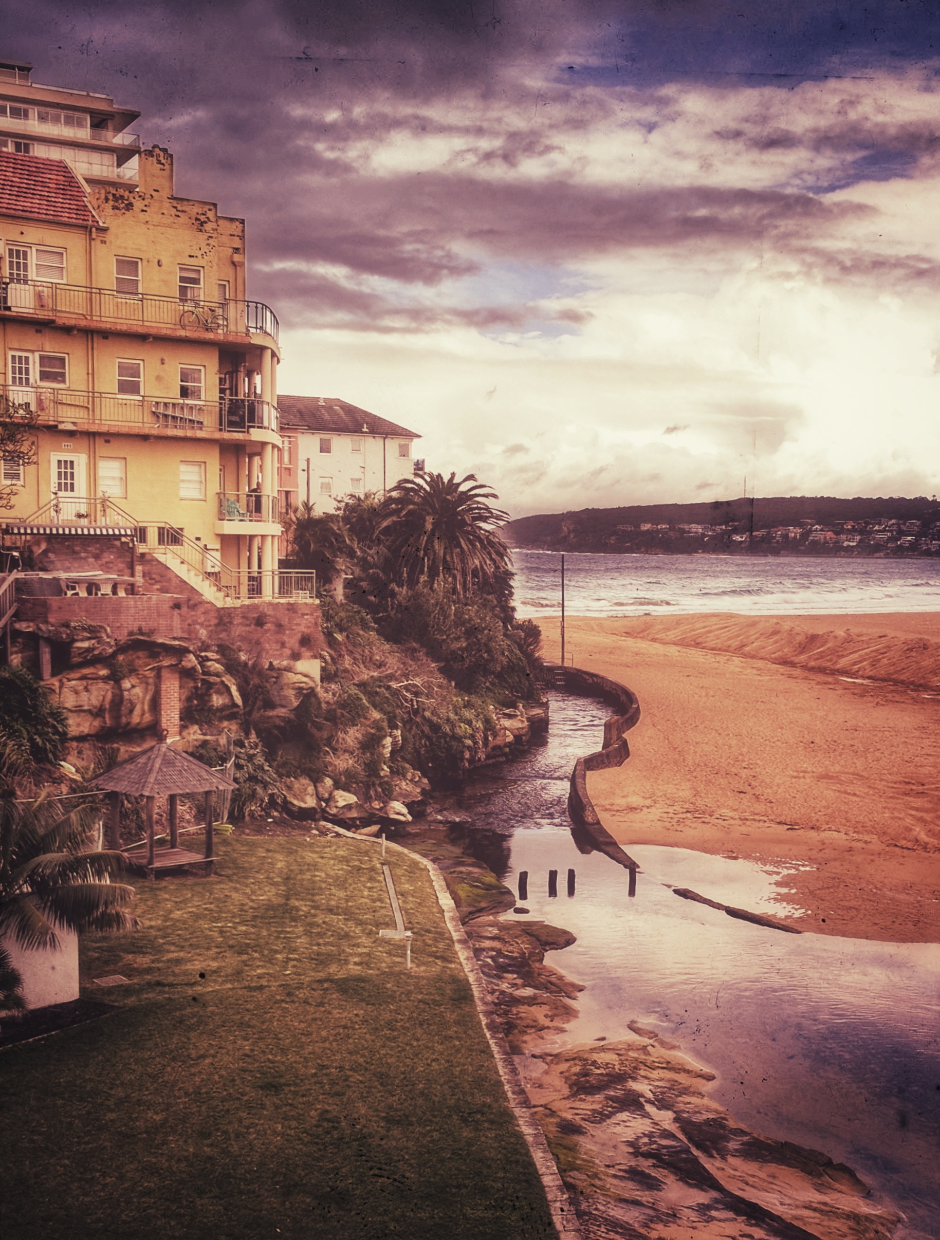 Heavily edited view of Queenscliff apartments and Manly Beach, Australia