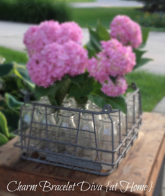 Hydrangeas vintage milk bottles floral arrangements