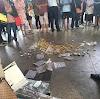 Vendedor ambulante tem empadinhas jogadas no chão por fiscal no Terminal de Carapina