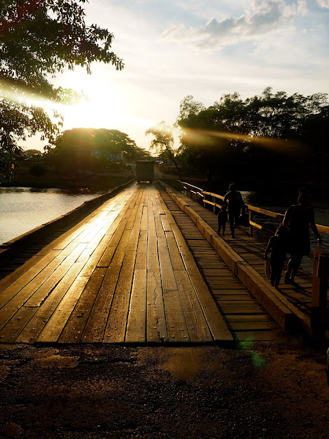 Wooden bridge into San Ignacio, Belize, at sunset