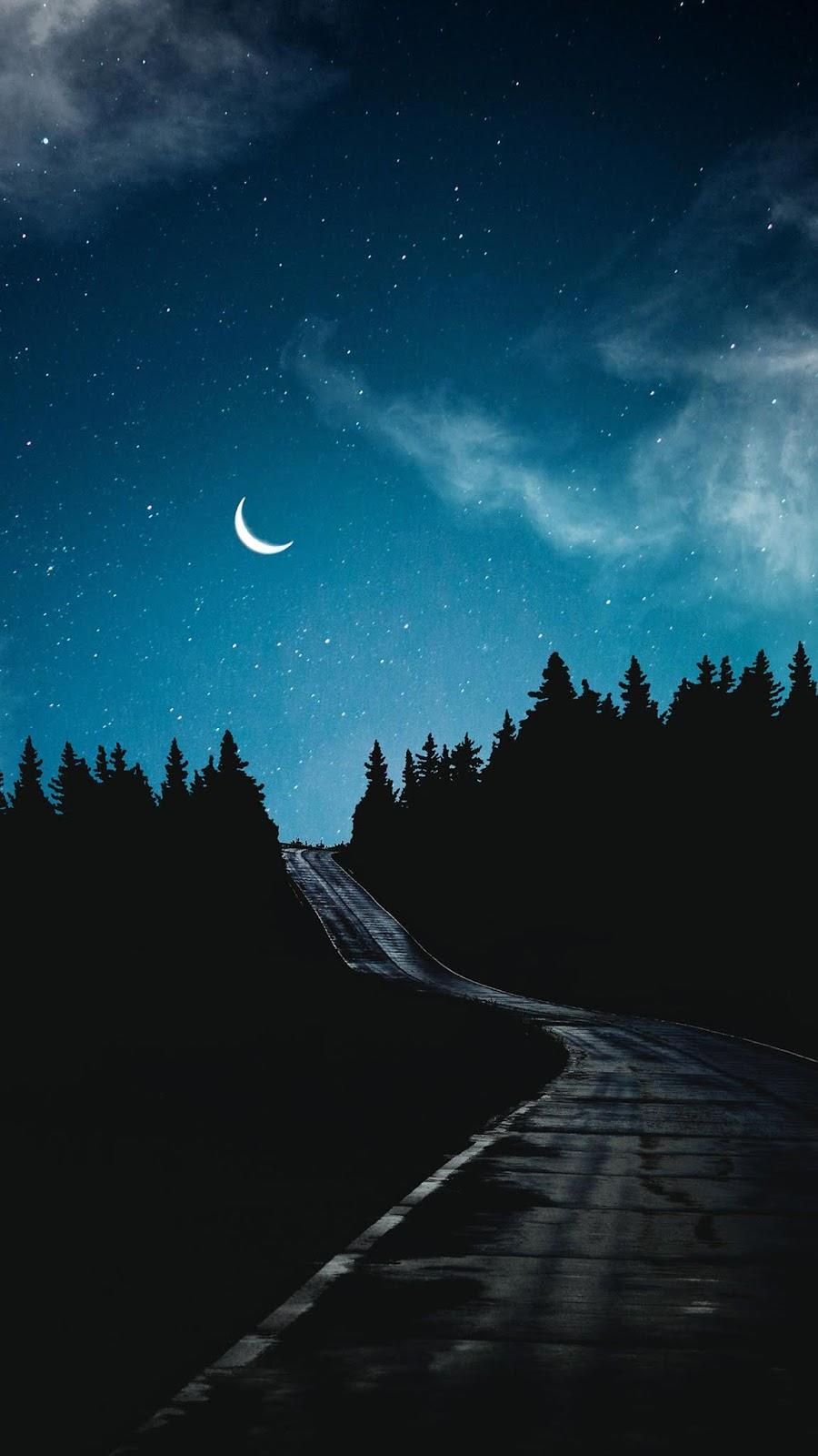 Road under crescent moon