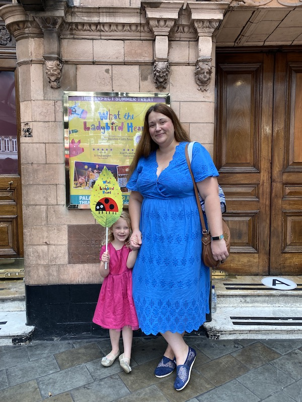 mum and daughter standing in front of palace theatre