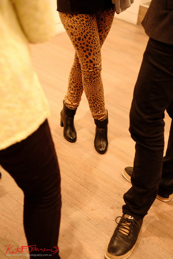 Leopard print leggings with black leather low cut boots.