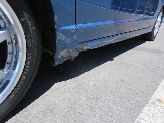Dented fender and rocker panel before collision repairs at Almost Everything Auto Body