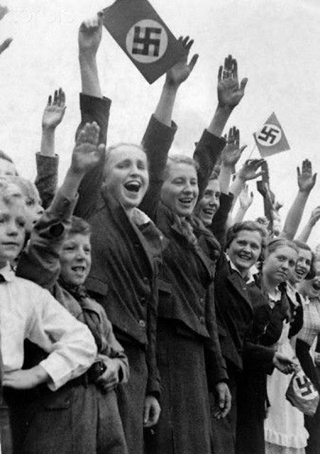 Women cheering Hitler in Czechoslovakia worldwartwo.filminspector.com