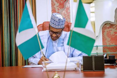 Buhari signs 2021 budget into law