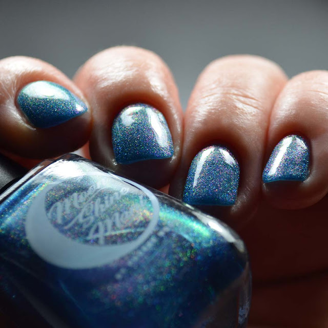 blue shimmer nail polish swatch different angle