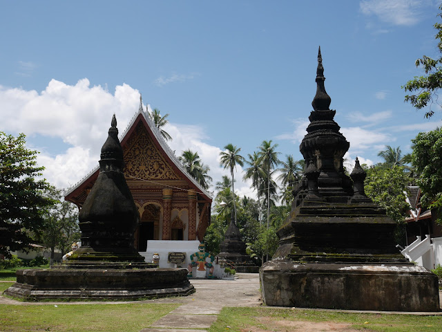 old stone chedis and the central sim at Wat Aham, Luang Prabang
