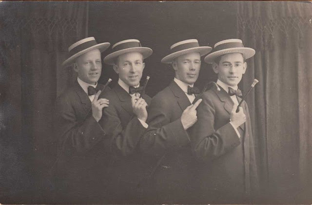 Barbershop Quartet publicity photo c. 1920. Four young men in straw skimmers and bow ties. Standing in front of the curtain. Jingles and other stories of The American Dream. marchmaton.com