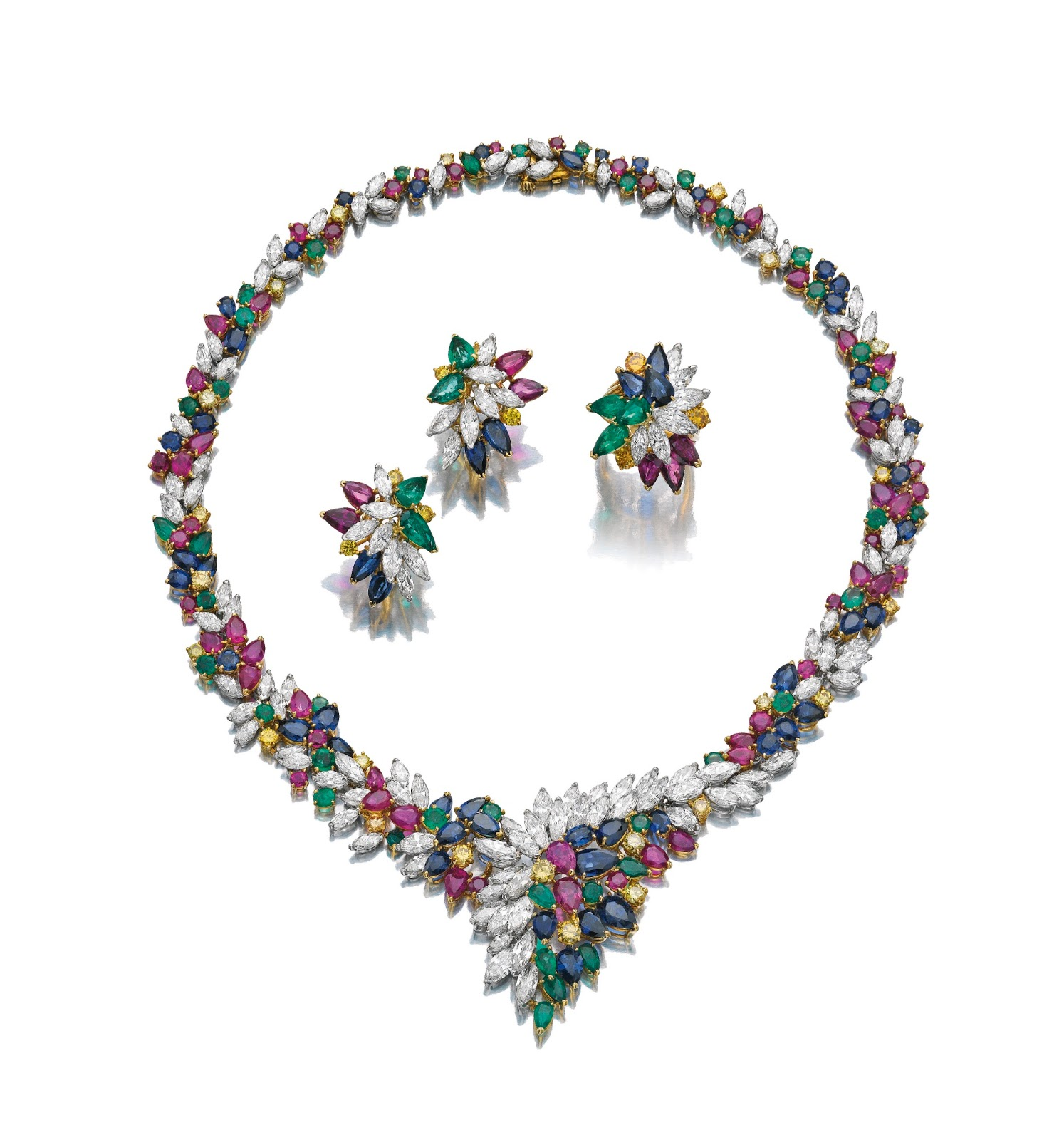 Historical Examples. of parure. A few steps from Emma a gentleman in a blue coat was talking of Italy with a pale young woman wearing a parure of pearls.