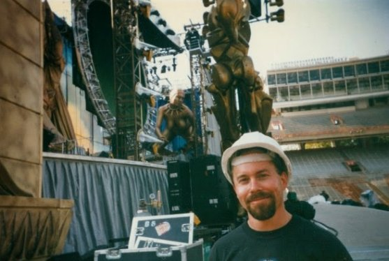 Tom Bowser standing in front of the main stage for a Rolling Stones concert he worked.