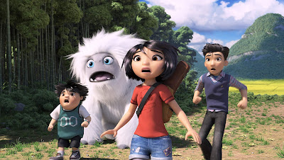 "Chloe Bennet, Albert Tsai, and Tenzing Norgay Trainor help Everest the yeti get home in a movie still for the 2019 animated film ""Abominable"""