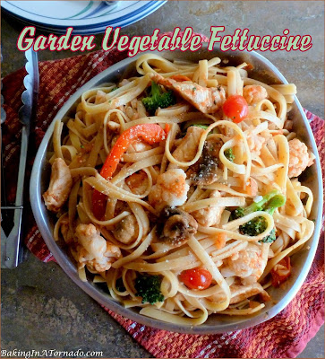 Garden Vegetable Fettuccine, a healthier dinner, includes lots of vegetables and lean chicken served over fettuccine. | Recipe developed by www.BakingInATornado.com | #recipe #dinner