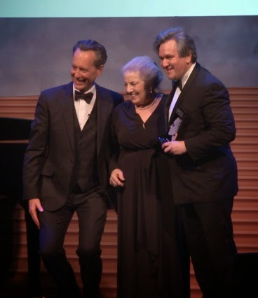 Sir Antonio Pappano receiving the Richard Strauss Anniversary Production award at the Opera Awards 2015, with Joyce Kennedy and Richard E Grant