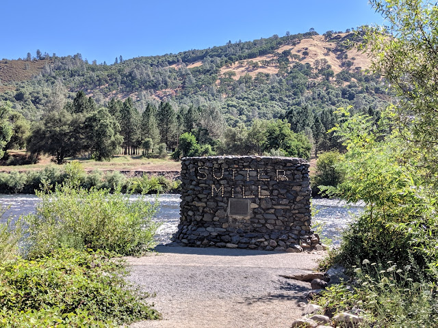 This chest-high stone monument marks the location on the American River.