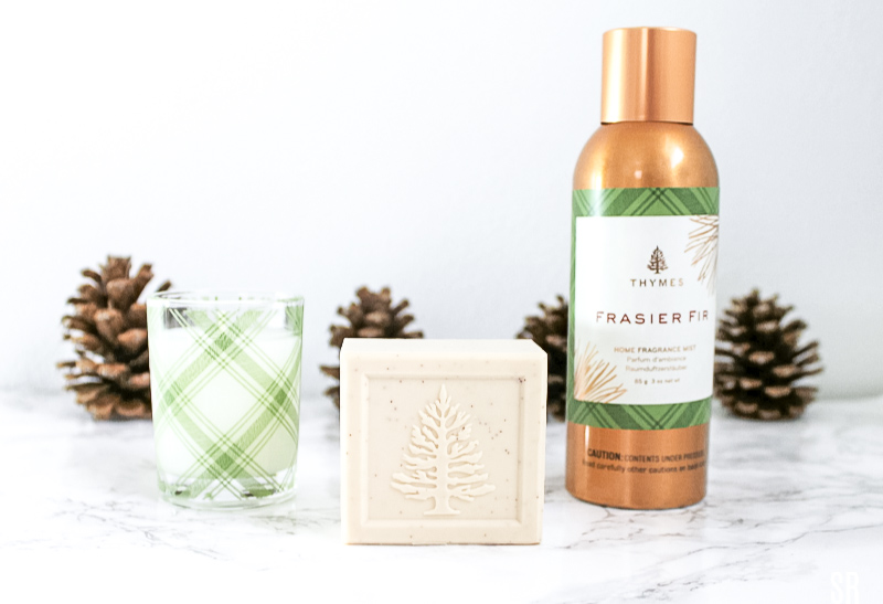 Thymes Frasier Fir home fragrance on a table