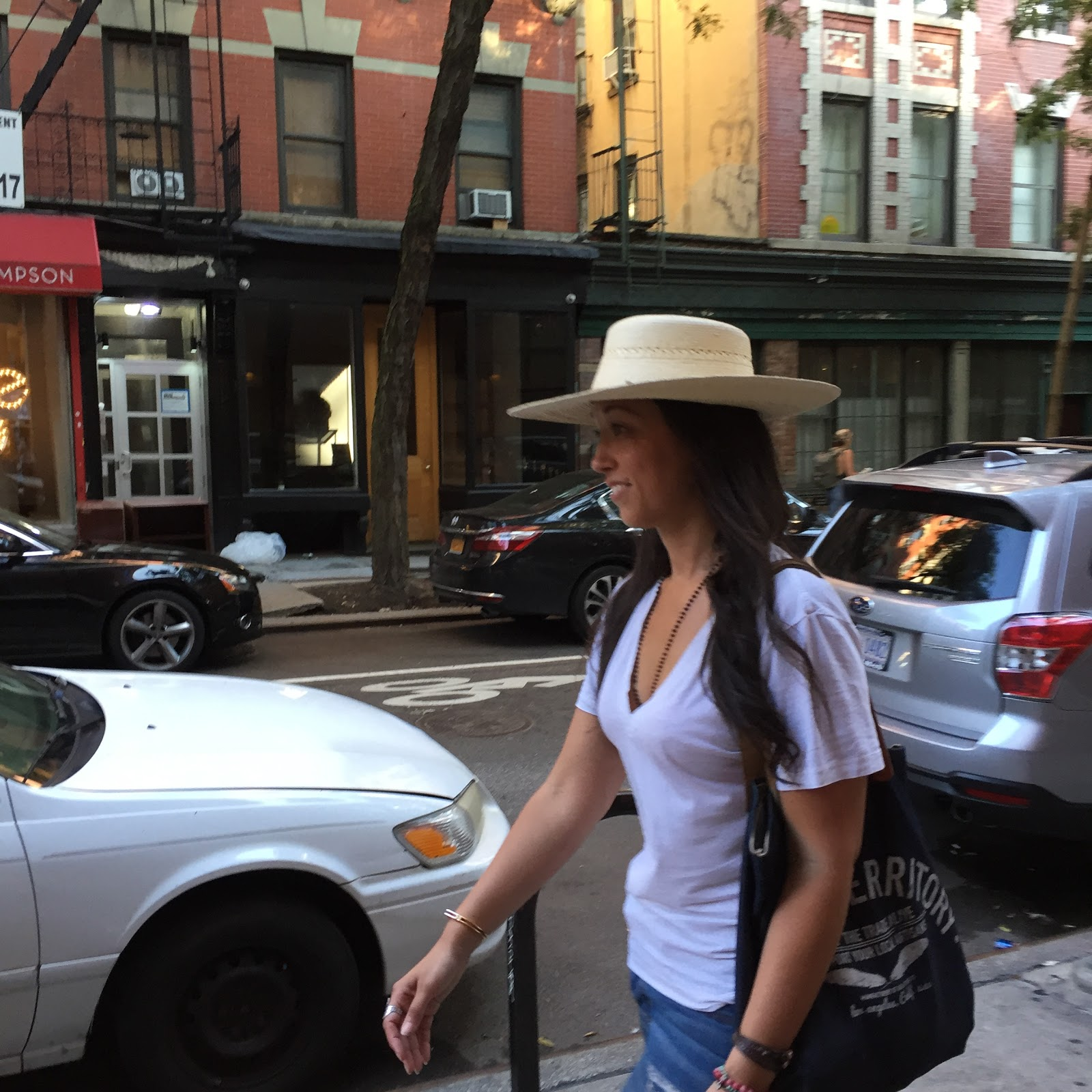 fe8acfabc7a Lady wearing wide brim sun protection travel hat from The Hat House in NYC