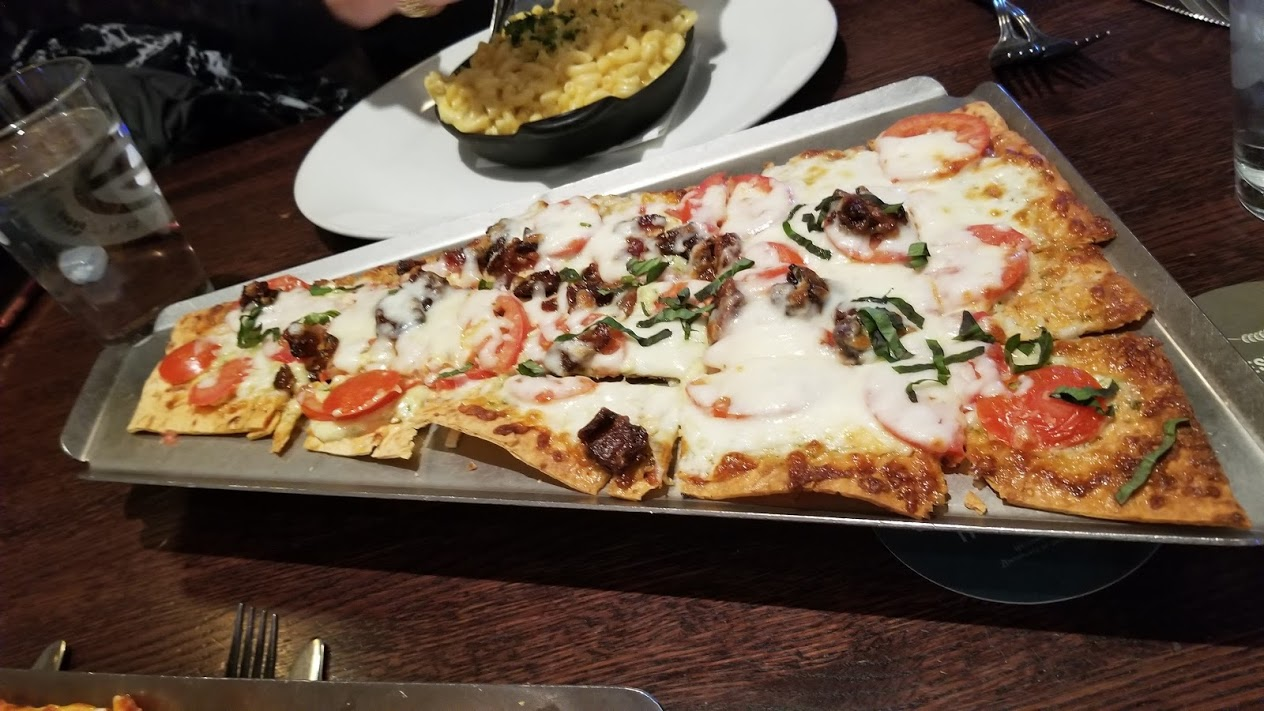 Maple pepper bacon flatbread, at Granite City Troy. $9 during happy hour!