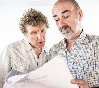 Richard Earl and Nicholas Briggs looking at a script